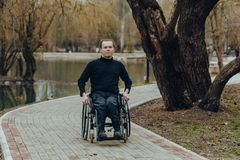 Portrait of a happy man on a wheelchair in a park stock photos