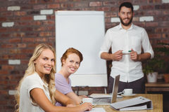 Portrait of happy man and women during presentation Stock Images