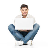 Portrait of  happy man working on laptop Stock Photography