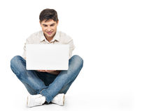 Portrait of  happy man working on laptop Royalty Free Stock Images