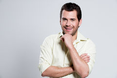 Portrait of happy man in yellow shirt. Royalty Free Stock Photo
