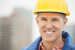 Portrait Of Happy Manual Worker. Close-up portrait of happy manual worker at construction site stock photos
