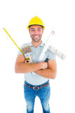Portrait of happy manual worker holding various tools Royalty Free Stock Photo