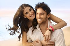 Portrait of happy married couple at the beach. Portrait of happy casual caucasian married couple at the beach. Handsome man, attractive young woman, smiling Stock Photo