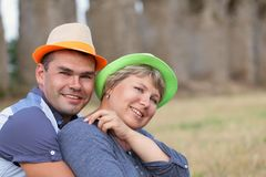 Portrait of happy married couple in hats Stock Photo