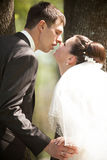 Portrait of happy married couple kissing Royalty Free Stock Photo