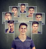 Portrait of a happy masked young man expressing different emotions stock photo