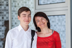 Portrait of happy mather with son on white wall,. Outdoor Royalty Free Stock Photography