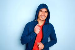 Happy mature asian man in stylish hoodie stock photos