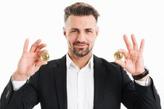 Portrait of a happy mature businessman dressed in suit Stock Image