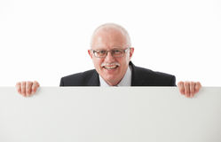 Portrait of a happy mature businessman holding empty white board Stock Photography