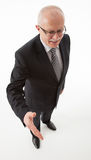 Portrait of a happy mature businessman offering handshake Royalty Free Stock Image