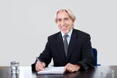 Portrait of a happy mature businessman working Stock Photography