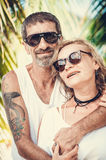 Portrait of happy mature couple at the beach Stock Image