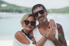 Portrait of happy mature couple at the beach Stock Images