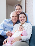 Portrait of happy mature couple with daughter and granddaughter Stock Photos