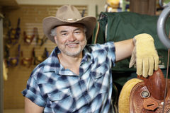 Portrait of a happy mature cowboy in feed store Stock Photography