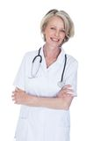 Portrait of happy mature female doctor. Isolated Over White Background Royalty Free Stock Photography