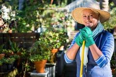 Portrait of happy mature gardener at garden stock photos