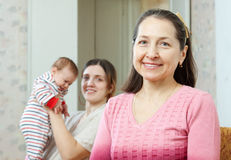Grandmother with  young mother with baby on background Stock Photography