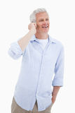 Portrait of a happy mature man using his mobile phone Stock Photography