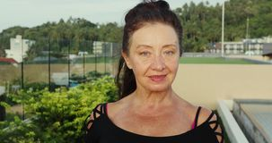 Portrait of a Happy Mature Senior Lady Smiling at the Camera stock video
