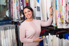 Portrait of happy mature woman with cloth specimens Stock Photography