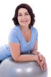 Portrait of happy mature woman with fitness ball isolated on whi Royalty Free Stock Image