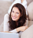 Portrait of happy mature woman with a laptop Royalty Free Stock Photos