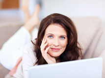 Portrait of a happy mature woman with a laptop Stock Image