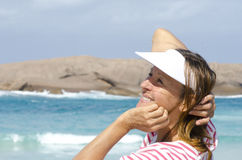Portrait happy mature woman at ocean Royalty Free Stock Images