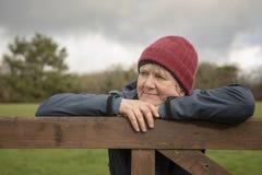 Happy mature woman outdoors. Portrait of happy mature woman outdoors royalty free stock photo
