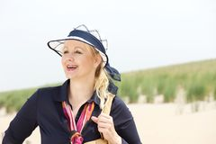 Portrait of a happy mature woman smiling at the beach Stock Images