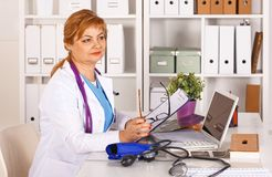 Portrait of happy medical doctor woman in office.  Stock Image
