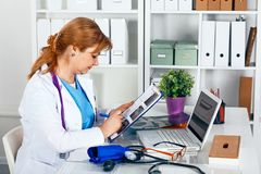Portrait of happy medical doctor woman in office.  Royalty Free Stock Photos