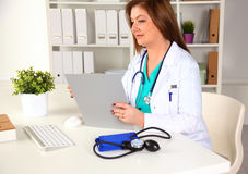 Portrait of happy medical doctor woman in office Stock Photos