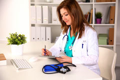 Portrait of happy medical doctor woman in office Stock Images