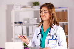 Portrait of happy medical doctor woman in office.  Royalty Free Stock Image