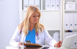 Portrait of happy medical doctor woman in office Stock Photography