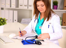 Portrait of happy medical doctor woman in office Royalty Free Stock Photos