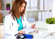 Portrait of happy medical doctor woman in office.  Stock Photos