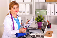 Portrait of happy medical doctor woman in office.  Royalty Free Stock Photo
