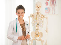 Portrait of happy medical doctor woman teaching stock image