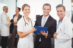 Portrait of happy medical team with clipboard Royalty Free Stock Image