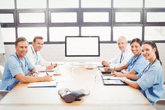 Portrait of happy medical team in conference room Stock Images