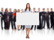 Portrait of happy men and women. Standing with a billboard against white background stock image