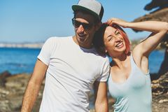 Happy man and woman standing together at seaside. Portrait of happy men and women standing together at seaside Royalty Free Stock Photo