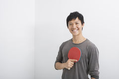 Portrait of happy mid adult man holding table tennis paddle Royalty Free Stock Photo