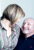 Portrait of happy middle age couple laughing. Portrait of happy middle age couple husband and wife looking at each other laughing Stock Photos
