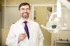 Happy dentist Stock Image